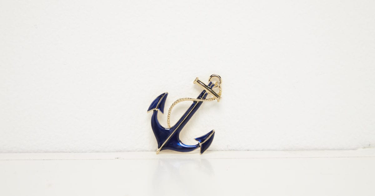 Ship's anchor against white background